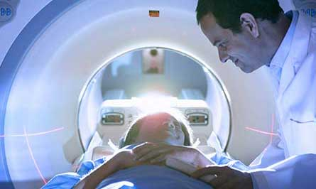 Patient in medical scanner with doctor